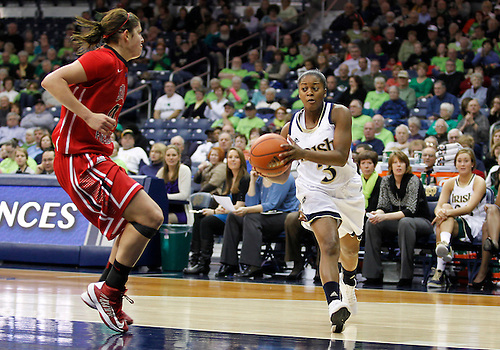 December 31, 2012:  Notre Dame guard Whitney Holloway (3) drives to the basket as St. Francis center Alli Williams (40) defends during NCAA Women's Basketball game action between the Notre Dame Fighting Irish and the St. Francis (PA) Red Flash at Purcell Pavilion at the Joyce Center in South Bend, Indiana.  Notre Dame defeated St. Francis 128-55.