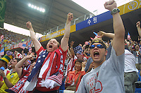 American soccer supporters react to an early goal by the United States national team, giving the team a suprising lead over heavily favored Portugal in the opening round 2002 World Cup match at Suwon World Cup stadium in Suwon, South Korea.
