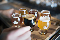 NWA Democrat-Gazette/CHARLIE KAIJO A flight of beers is shown, Thursday, August 8, 2019 at the Bike Rack Brewing in Bentonville.<br /> <br /> Bike Rack Brewing is distributing into Little Rock now.