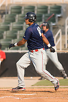 First baseman Carlos Fernandez-Oliva (12) of the Greenville Drive follows through on his swing at Fieldcrest Cannon Stadium in Kannapolis, NC, Sunday August 10, 2008. (Photo by Brian Westerholt / Four Seam Images)