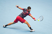 Novak Djokovic (SRB) (3) against Roger Federer (SUI) (2) in the semi-finals. Roger Federer beat Novak Djokovic 6-1 6-4..International Tennis - Barclays ATP World Tour Finals - O2 Arena - London - Day 7 - Sat 27 Nov 2010..© Frey - AMN Images, Level 1, Barry House, 20-22 Worple Road, London, SW19 4DH.Tel - +44 208 947 0100.Email - Mfrey@advantagemedianet.com.Web - www.amnimages.photshelter.com