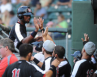 Center fielder Jordan Akins (5) of the Hickory Crawdads is congratulated after scoring a run in a game against the Greenville Drive on Sunday, September 2, 2012, at Fluor Field at the West End in Greenville, South Carolina. Akins is the Texas Rangers' No. 12 prospect, according to Baseball America. Hickory won, 8-4. (Tom Priddy/Four Seam Images)