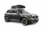 Gray 2014 Mini Cooper Countryman compact CUV car with a cargo roof box isolated on white background with clipping path