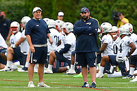 July 24, 2014 - Foxborough, Massachusetts, U.S.- New England Patriots head coach Bill Belichick (left) and defensive coordinator Matt Patricia (right) watch team drills  during the New England Patriots training camp held at Gillette Stadium in Foxborough Mass.Eric Canha/CSM