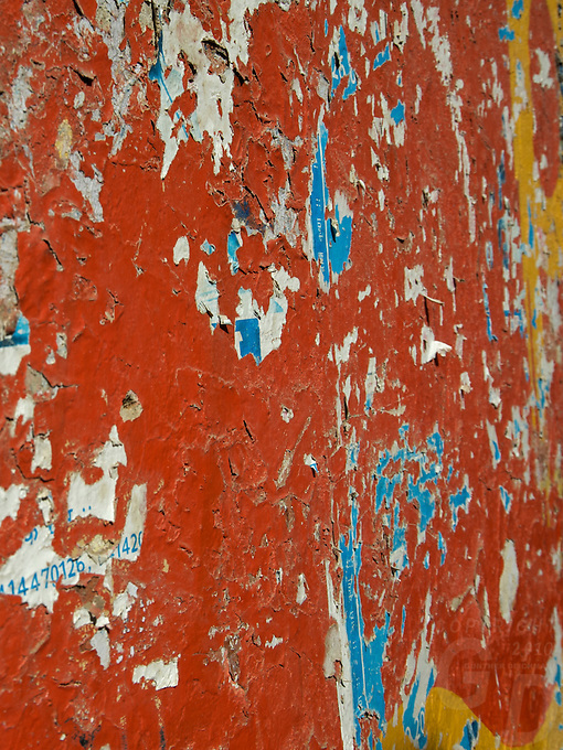 """peeling Paint on a wall, Jaisalmer the old City and fort.J a i s a l m e r   J a i s a l m e r  n i c k n a m e d   """" T h e   G o l d e n   C i t y """" ,   i s   a   t o w n   i n   t h e   I n d i a n   s t a t e   o f   R a j a s t h a n .   T h e   t o w n   s t a n d s   o n   a   r i d g e   o f   y e l l o w i s h   s a n d s t o n e ,   c r o w n e d   b y   a   f o r t ,   w h i c h   c o n t a i n s   t h e   p a l a c e   a n d   s e v e r a l   o r n a t e   J a i n   t e m p l e s .   M a n y   o f   t h e   h o u s e s   a n d   t e m p l e s   a r e   f i n e l y   s c u l p t u r e d .   I t   l i e s   i n   t h e   h e a r t   o f   t h e   T h a r   D e s e r t   a n d   h a s   a   p o p u l a t i o n   o f   a b o u t   7 8 , 0 0 0 .   I t   i s   t h e   a d m i n i s t r a t i v e   h e a d q u a r t e r s   o f   J a i s a l m e r   D i s t r i c t ....Jaisalmer Fort is one of the largest of desert forts of the world. It is situated in Jaisalmer city in Indian state of Rajasthan. It was built in 1156 AD by the Bhati Rajput ruler Rawal Jaisal, from where it derives it name. The fort stands proudly admist the golden stretches of the great Thar Desert, on Trikuta Hill and had been the scene of many battles. Its massive yellow sandstone walls are a tawny lion color during the day, turning to a magical honey-gold as the sun sets and camouflages the fort making it appear a part of the picturesque yellow desert. Thus, it is also known as the """"Golden Fort"""".."""