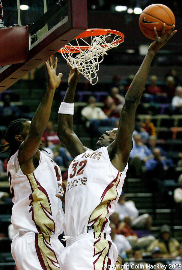 TALLAHASSEE, FL 11/3/09-FSU-DELTA BB09 CH11-Florida State's Solomon Alabi, right, and Ryan Reid both go for an assist against Delta State's during first half action Tuesday at the Tallahassee-Leon County Civic Center. The Seminoles beat the Statesmen 81-38 in their first exhibition game of the season...COLIN HACKLEY PHOTO