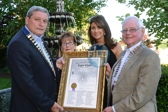 07/06/2013 - The District Governor of Lions Clubs International, Joe Smith (right), presents Drogheda Lions Club President Brian Browning with its new Charter. Looking on are Monica Smith and Catherine Moore. Photo: Andy Spearman www.newsfile.ie