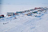 Aerial of Sonny Lindner as he arrives in Shaktoolik during Iditarod 2009