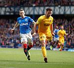 14.09.2019 Rangers v Livingston: Ryan Kent pulls up injured after chasing Ricki Lamie