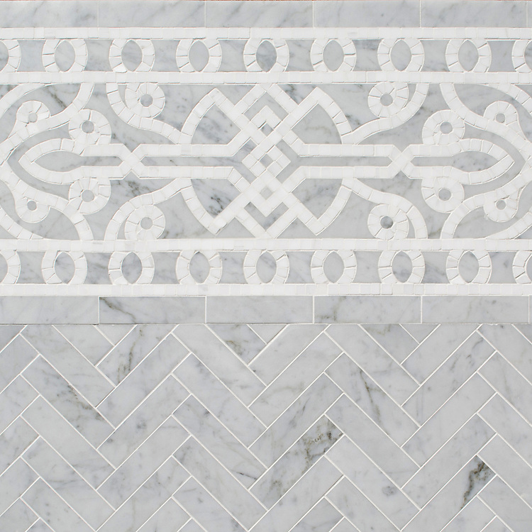 """Sienna 9 5/8"""", a hand-cut and waterjet mosaic border, shown in honed Carrara and Thassos, is part of the Miraflores collection by Paul Schatz for New Ravenna."""