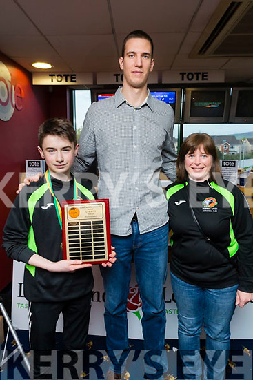 Dusan Bogdanovic (Tralee Warriors) pictured presenting the under 16 boys division 3 Perpetual Shield to Sean Burke O'Donoghue (Rathmore Ravens) and Mary Darmody Manager Rathmore Ravens at the Kerry Area Basketball Board awards at Kingdom Greyhound Stadium, Tralee on Tuesday night last.