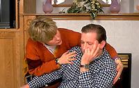 Wife age 25 comforting distraught husband.   Woodbury  Minnesota USA