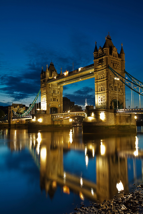 Tower Bridge reflected in the River Thames at dawn, London, Uk