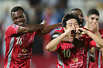 Qatar's Lekhwiya player Nam Tae Hee (R) celebrate with teammates Mohammed Abdullah after scoring a goal against   Iran's Persepolis  during their AFC Champions League soccer match at Abdullah bin Khalifa Stadium  in Doha April 22, 2015.  REUTERS/Fadi Al-Assaad