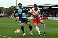 Garry Thompson of Wycombe Wanderers and Jamie McCombe of Stevenage in action during the Sky Bet League 2 match between Stevenage and Wycombe Wanderers at the Lamex Stadium, Stevenage, England on 17 October 2015. Photo by PRiME Media Images.