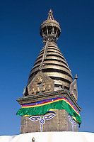 Kathmandu, Nepal.  The Harmika (Square Base) Portion of the Swayambhunath Stupa, with the Watchful Eyes of the Buddha.  Below the eyes is the Nepali number one, symbolizing the unity of life.  Above the harmika is a tapering section of 13 stages, representing the 13 stages of perfection on the way to nirvana.