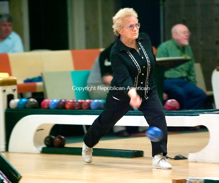 WATERBURY, CT- 28 APRIL 07- 042807JT09-<br /> Jody Buschman of Baltimore, Md. takes her turn during the opening day of the 77th Duckpin Bowling National Championship for amateurs and professionals at Perillo's Bowling Alley in Waterbury on Saturday. The event takes place on four consecutive weekends.<br /> Josalee Thrift Republican-American