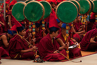 Buddhist Monks playing drums in a Losar ceremony, Sikkim, India