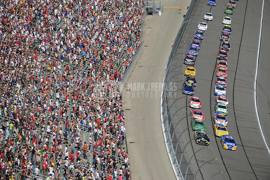 Sept. 27, 2008; Kansas City, KS, USA; NASCAR Nationwide Series driver Kevin Harvick (33) and Mark Martin (5) lead the field to the green flag during the Kansas Lottery 300 at Kansas Speedway. Mandatory Credit: Mark J. Rebilas-