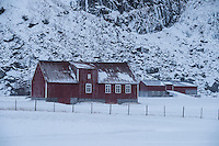 Traditional red barns in winter, Uttakleiv, Vestvågøy, Lofoten Islands, Norway