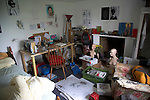 Inside untidy art student teenager's bedroom
