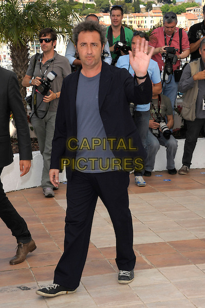 PAOLO SORRENTINO.'This Must Be The Place' photocall at Palais des Festivals 64th International Cannes Film Festival, France.20th May 2011..full length black jacket blue t-shirt hand waving .CAP/PL.©Phil Loftus/Capital Pictures.