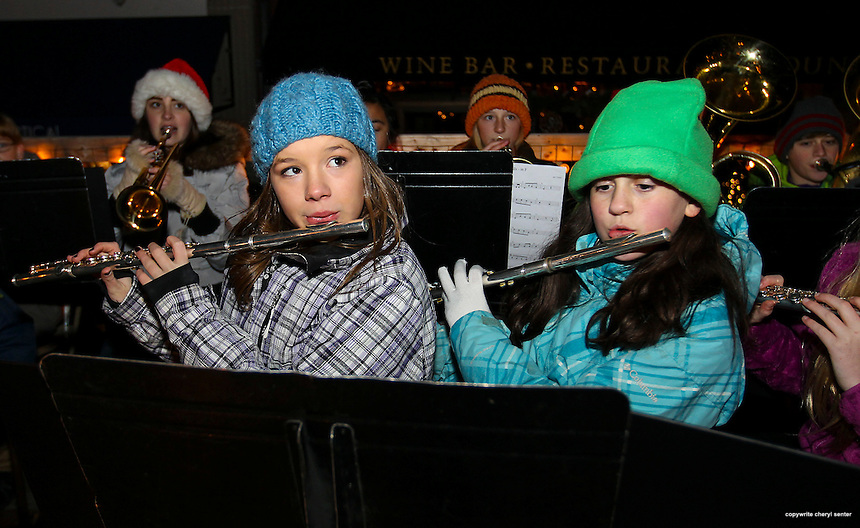 Members of the Portsmouth Middle School Holiday Ensemble, front from left, Isabelle Merosola, 12, of Newington, and, Janna Sargent, 12, of Portsmouth play holiday music with fellow band members, part of the Portsmouth Illuminated Holiday Parade and Tree Lighting event in Portsmouth, N.H., Saturday, Dec. 7, 2013.  (Portsmouth Herald Photo Cheryl Senter)