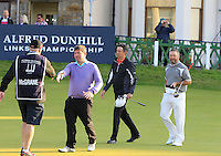 Peter Lawrie (IRL) and Damien McGrane (IRL) on the 18th green during Round 2 of the 2015 Alfred Dunhill Links Championship at Kingsbarns in Scotland on 2/10/15.<br /> Picture: Thos Caffrey | Golffile