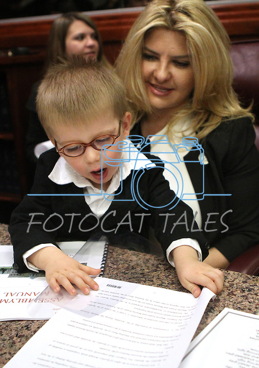 Nevada Assemblywoman Michele Fiore, R-Las Vegas, holds her grandson Jake Willis during the opening day of the 77th Legislative Session in Carson City, Nev. on Monday, Feb. 4, 2013. <br />