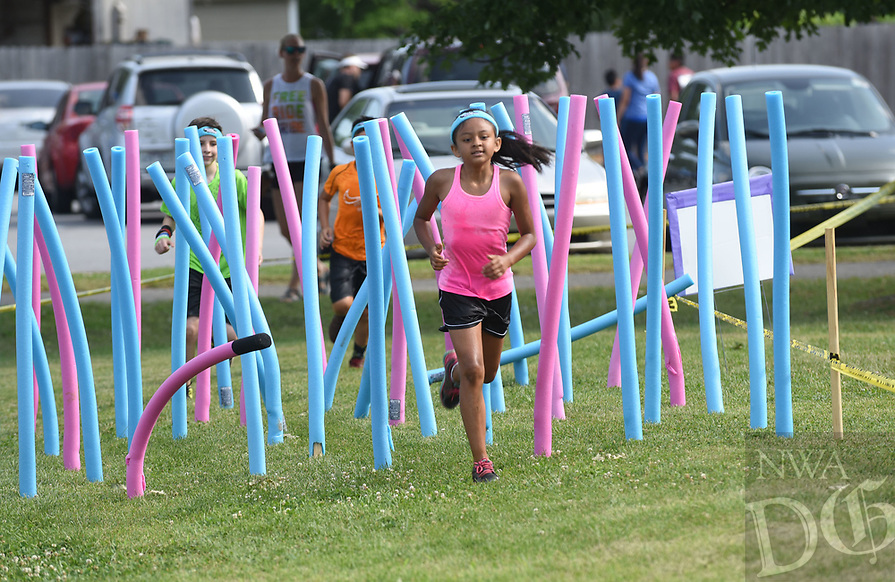 NWA Democrat-Gazette/FLIP PUTTHOFF <br /> OBSTACLE RUNAROUND<br /> Kids run through a noodle maze on Saturday June 9 2018 during the Obstacle Runaround at the Jones Center for Families in Springdale Youngsters age 5-12 took part in the one-mile run with 15 obstacles on the course including a slip and slide, belly crawl, and water balloon toss. &quot;It's our version of a mud run for kids,&quot; said Stephen Paul with the Jones Center.