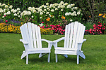 Adirondack Chairs in the flower Garden on Mackinac Island, Michigan, USA