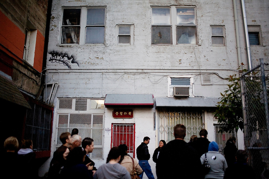 """Cynthia Yee points out a building once used as a brothel on Hang Ah Alley, or Pagoda Alley, in San Francisco, Ca., on Friday, June 18, 2010. Hang Ah means """"fragrant"""" in Chinese. The story goes that a prostitute fell in love with German chemist who opened a perfumery. When he shipped off to war, he never returned, and she later died of heartbreak. Her ghost supposedly remains, upstairs, looking out the window waiting for her husband to return."""