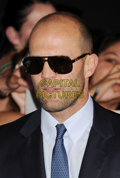 "Jason Statham.""The Expendables 2"" Los Angeles Premiere held at Grauman's Chinese Theatre, Los Angeles, California, USA..August 15th, 2012.headshot portrait black stubble facial hair tie blue shirt white sunglasses shades  .CAP/ROT/TM.©Tony Michaels/Roth Stock/Capital Pictures"