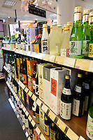 Sake on sale in the Japan Centre shop near Piccadilly Circus, London, UK, 5 May 2014. Sake rice wine has become popular in London. Many Japanese restaurants and bars serve sake by the glass and bottle. Sake cocktails are especially popular.