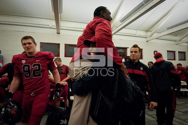 STANFORD, CA - NOVEMBER 26: Coaches Pep Hamilton and Derek Mason celebrate a win against Notre Dame at Stanford Stadium. Stanford won their last game of the season 28-14 over the Irish.