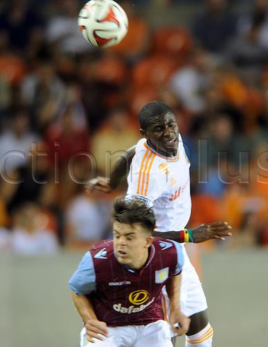 26.07.2014. Houston, Texas, USA.  Houston Dynmao  defender Kofi Sarkodie heads the ball over Jack Grealish during Houstons 1 - 0 loss to Aston Villa at BBVA Compass Stadium in Houston, TX.