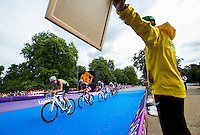 07 AUG 2012 - LONDON, GBR - Brazilian coach Sergio Santos (in yellow) shouts bike split times to Diogo Sclebin (BRA) of Brazil (left) during the men's London 2012 Olympic Games Triathlon in Hyde Park in London, Great Britain (PHOTO (C) 2012 NIGEL FARROW)