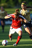 Valeria Kleiner (GER) and Vicki DiMartino (USA) compete for the ball..FIFA U17 Women's World Cup, Semi Final, Germany v USA, QEII Stadium, Christchurch, New Zealand, Thursday 13 November 2008. Photo: Renee McKay/PHOTOSPORT