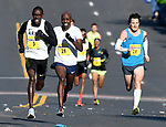 Three of the male runners bunched up coming up Main Street, Paul Chelimo (5) Kirubel Erasse (19) and Chris Thompson (18)  at the finish line, during the 81st running of the Manchester Road Race, Thursday, November 23, 2017, in  Manchester. (Jim Michaud / Journal Inquirer)