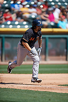 Nick Tanielu (34) of the Fresno Grizzlies hustles to first base against the Salt Lake Bees at Smith's Ballpark on September 3, 2018 in Salt Lake City, Utah. The Grizzlies defeated the Bees 7-6. (Stephen Smith/Four Seam Images)