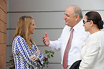 Shari Arison, left, owner of the Arison Group, and Yitzhak Tshuva, center (with his wife), controller of Delek Group, at an opening event of a new desalination facility in Hadera, Israel, on Sunday, May 16, 2010.<br />