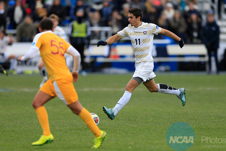 KANSAS CITY, MO - DECEMBER 03:  Jon Ander (11) of Wingate University looks for an opening in the University of Charleston defense during the Division II Men's Soccer Championship held at Children's Mercy Victory Field at Swope Soccer Village on December 03, 2016 in Kansas City, Missouri. Wingate beat Charleston 2-0 to win the National Championship. (Photo by Jack Dempsey/NCAA Photos via Getty Images)