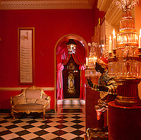 The exotic, candle lit red hall of the home of Mrs Ayisha Nadir