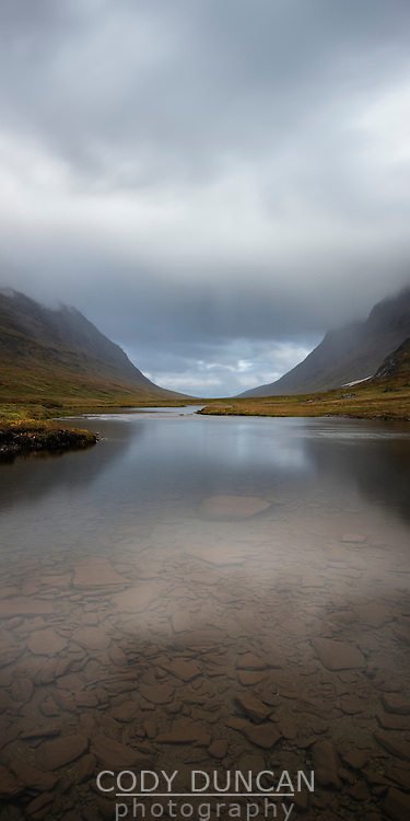 River flows through the scenic Syterskalet mountain valley near Viterskals hut, Kungsleden trail, Lapland, Sweden
