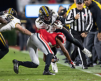 ATHENS, GA - NOVEMBER 09: Larry Rountree III #34 of the Missouri Tigers is tackled by Eric Stokes #27 of the Georgia Bulldogs during a game between Missouri Tigers and Georgia Bulldogs at Sanford Stadium on November 09, 2019 in Athens, Georgia.