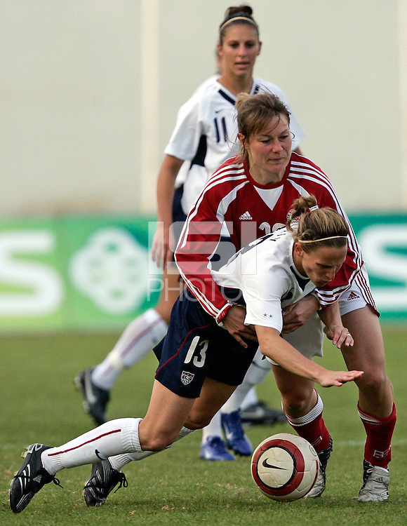 Vila Real de Santo Antonio, PORTUGAL: Denmark player holds Kristine Llly at the VRS Antonio Stadium in VRS Antonio, March 14, 2007, during the final of Algarve Women´s Cup soccer match between USA and Denmark. USA won 2-0 Paulo Cordeiro/International Sports Images