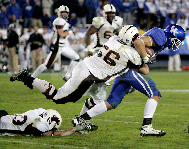 Louisiana Monroe's Johnathan Gill tries to tackle sophomore free safety Matt Lentz in the second half of UK's 36-13 defeat of Louisiana Monroe. Photo by Britney McIntosh | Staff
