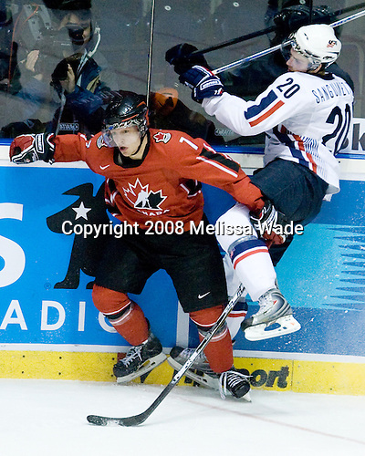Stefan Legein (Canada 7) and Bobby Sanguinetti (USA 20) collide. Team Canada defeated Team USA 4-1 on Friday, January 4, 2008, during the World Junior Championship at CEZ Arena in Pardubice, Czech Republic.  The result put Team Canada into the gold medal game and Team USA into the bronze medal game. Legein plays for the Niagara Ice Dogs and is a 2007 second round draft pick of the Columbus Blue Jackets while Sanguinetti plays for the Brampton Battalion and was drafted 21st overall in 2006 by the New York Rangers.
