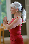 Mature woman exercising, close-up