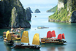 Halong Bay Sails 01 - Tourist junk cruise boats with red and yellow sails, Halong Bay, Viet Nam.
